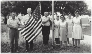 In July of 1966 The Fortville VFW Ladies Auxiliary presented this flag to the cemetery. Jim Girt/ caretaker, Cecil Blaydes/President of the Cemetery Board, Horace Wise/Cemetery Treasurer right of the flagpole are Mrs. Ruth Girt, Mrs. Mildred Oakes/Auxiliary President, Rosemary True/Auxiliary Secretary, and Mrs. Irene Durham/Auxiliary Vice President.